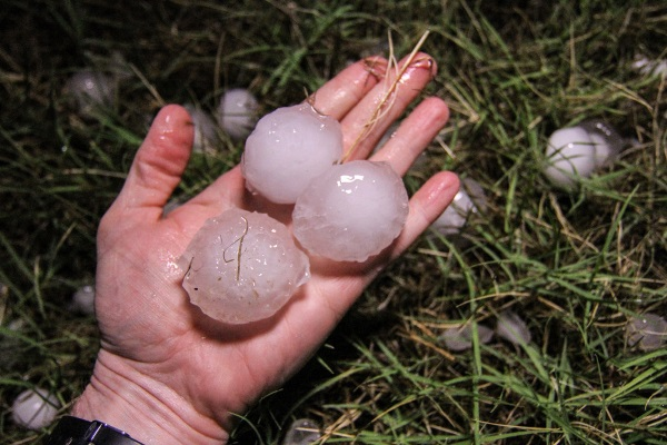 hailstones the size of huge marbles on a palm