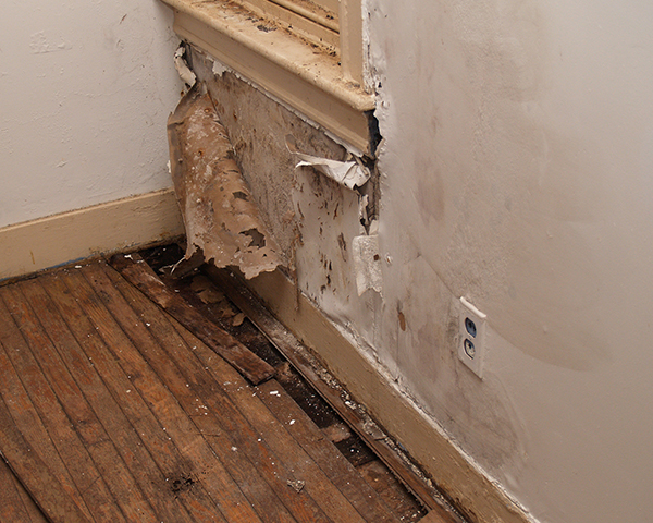 A water damaged interior wall of an old house.