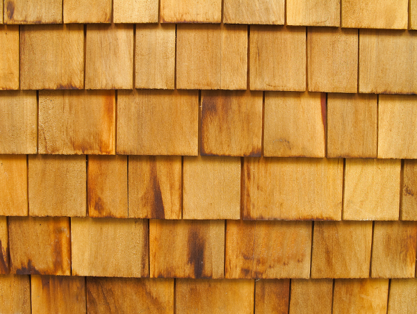 brown treated wood shingle surface