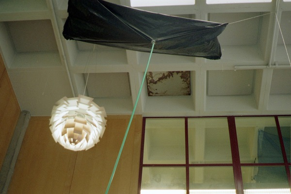 using tarpaulin to catch water indoors