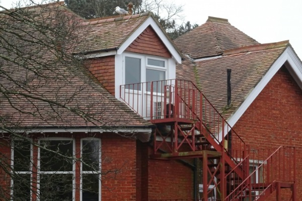 a home with a dormer window staircase