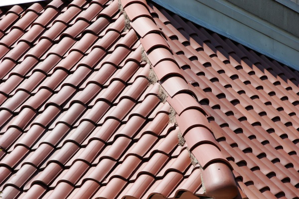 double roman clay tile roofs on a sloped roof
